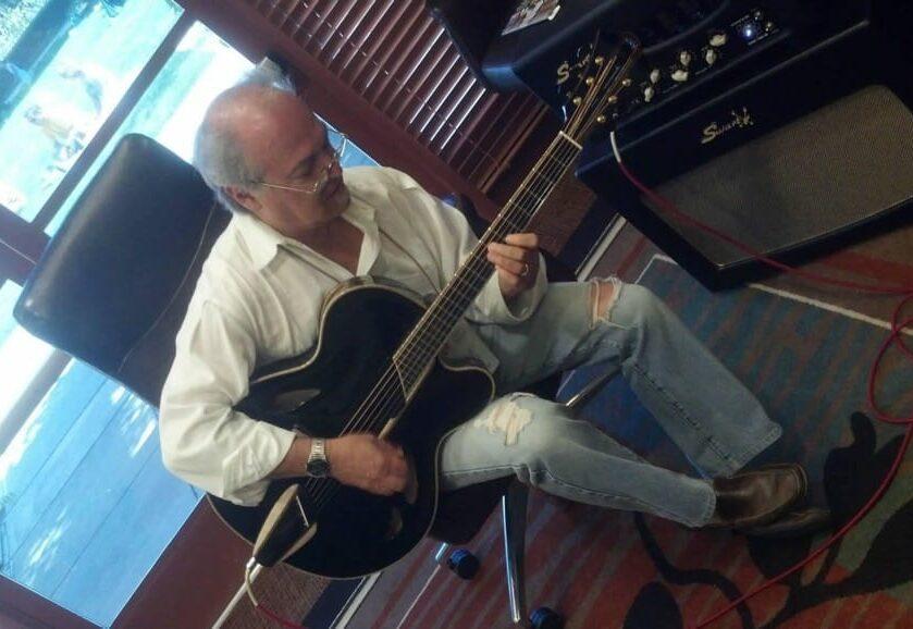 Paul Asbell playing his Mirabella guitar