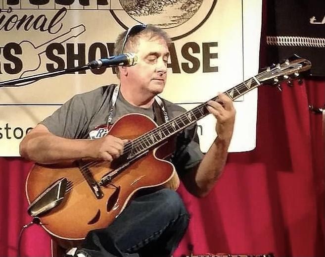 Ray Matuzza playing his Mirabella guitar
